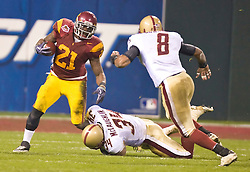 Dec 26, 2009; San Francisco, CA, USA;  Southern California Trojans running back Allen Bradford (21) is tackled by Boston College Eagles linebacker Mike McLaughlin (34) during the first quarter of the 2009 Emerald Bowl at AT&T Park.  USC defeated BC 24-13.