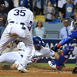 Los Angeles Dodgers Charlie Culberson (37) scores past Chicago Cubs catcher Willson Contreras in the sixth inning of a National League Championship Series baseball game at Dodger Stadium on Saturday, Oct. 14, 2017 in Los Angeles. (Photo by Keith Birmingham, Pasadena Star-News/SCNG)