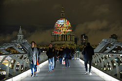 "© Licensed to London News Pictures. 27/11/2019. LONDON, UK.  William Blake's final masterpiece is projected onto the iconic dome of St Paul's Cathedral, in celebration of the artist's birthday.  The illustration of ""Ancient of Days"", 1827, can be seen until 1 December as part of a collaboration between St Paul's Cathedral and Tate Britain, which is currently staging the UK's largest survey of work for a generation.  Photo credit: Stephen Chung/LNP"