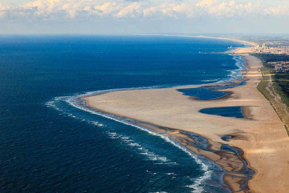 Nederland, Zuid-Holland, Gemeente Westland, 15-07-2012; Delflandse Kust ter hoogte van Ter Heijde en Monster, Den Haag aan de horizon.<br /> De Zandmotor is een kunstmatig schiereiland ontstaan door het opspuiten van zand voor de kust. Wind, golven en stroming zullen het zand langs de kust verspreiden waardoor breder stranden en duinen ontstaan. De zandmotor is een experiment in het kader van kustonderhoud en kustverdediging. <br /> Sand Engine, artificial peninsula build by the raising of sand for the coast of Ter Heijde (near the Hague, at the horizon). Wind, waves and currents will distribute the sand along the coast yielding wider beaches and dunes along the coastline. The Sand Engine is a experiment for coastal maintenance of coastal defense.<br /> luchtfoto (toeslag); aerial photo (additional fee required) foto Siebe Swart / photo Siebe Swart