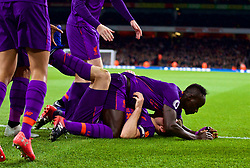 LONDON, ENGLAND - Saturday, November 3, 2018: Liverpool's captain James Milner is floored by team-mate Sadio Mane as he celebrates the first goal during the FA Premier League match between Arsenal FC and Liverpool FC at Emirates Stadium. The game ended in a 1-1 draw. (Pic by David Rawcliffe/Propaganda)
