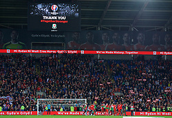 CARDIFF, WALES - Tuesday, October 13, 2015: Wales players and supporters celebrate qualifying for the finals after the 2-0 victory over Andorra during the UEFA Euro 2016 qualifying Group B match at the Cardiff City Stadium. (Pic by Barry Coombs/Propaganda)