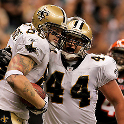 2009 August 14: New Orleans Saints tight end Jeremy Shockey (88) celebrates with FB Heath Evans (44) after scoring a touchdown during a preseason opener between the Cincinnati Bengals and the New Orleans Saints at the Louisiana Superdome in New Orleans, Louisiana.