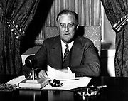 Franklin Delano Roosevelt (1882-1945), 32nd President of the United States of America 1933-1945, giving one of his 'fireside' broadcasts to the American nation during.