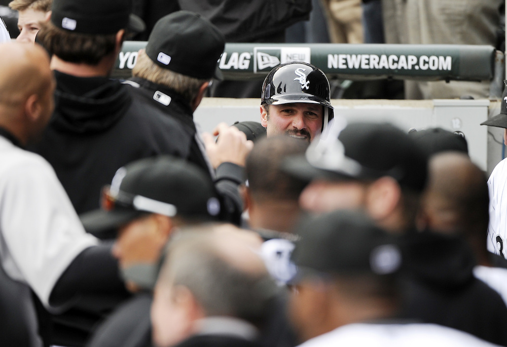 CHICAGO - APRIL 13:  Paul Konerko #14 of the Chicago White Sox celebrates with teammates after scoring a run against the Detroit Tigers in the sixth inning on Opening Day, April 13, 2011 at U.S. Cellular Field in Chicago, Illinois.  The White Sox defeated the Tigers 5-2.  (Photo by Ron Vesely)   Subject:  Paul Konerko