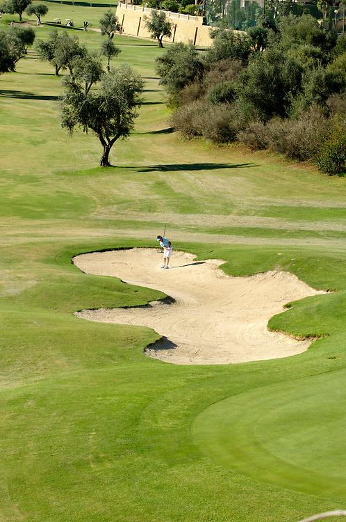 Lady golfer in a bunker on a Costa del Sol, Bunker