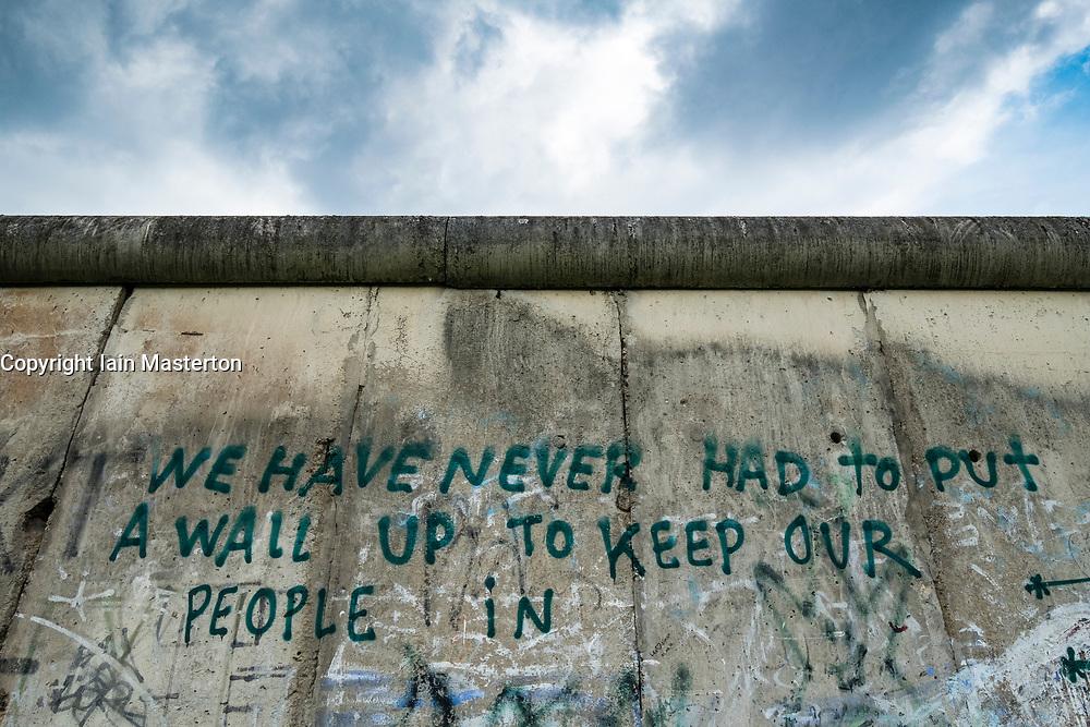 Graffiti on former Berlin Wall at Berlin Wall memorial park at Bernauer Strasse in Berlin, Germany
