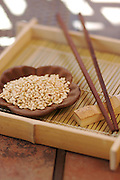 Organic Ohsawa Sweet Brown Rice in a Japanese wood flower-shape bowl with chopsticks