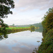 Both banks of the River Don in Yorkshire on a misty september morning. The river was once the most polluted in England but has now recovered