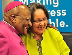 Image ©Licensed to i-Images Picture Agency. 11/08/2014. Cape Town, South Africa. Archbishop Emeritus Desmond Tutu with Mrs Patricia De Lille, Executive Mayor of Cape Town, during a press conference announcing the proposed lease of the Granary, a 203 year old building in the centre of Cape Town as the new home of the Desmond and Leah Tutu Legacy Foundation Centre. Picture by Roger Sedres / i-Images