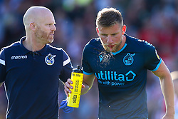 Alfie Kilgour of Bristol Rovers spits water and blood - Mandatory by-line: Robbie Stephenson/JMP - 14/09/2019 - FOOTBALL - Sincil Bank Stadium - Lincoln, England - Lincoln City v Bristol Rovers - Sky Bet League One