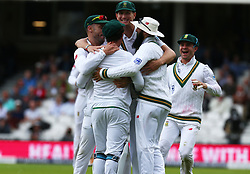 July 27, 2017 - London, United Kingdom - Quinton de Kock of South Africa  celebrate the catch of England's Joe Root  bowled by Vernon Philander of South Africa .during the International Test Match Series Day One match between England and South Africa at  The Kia Oval Ground in London on July 27, 2017  (Credit Image: © Kieran Galvin/NurPhoto via ZUMA Press)