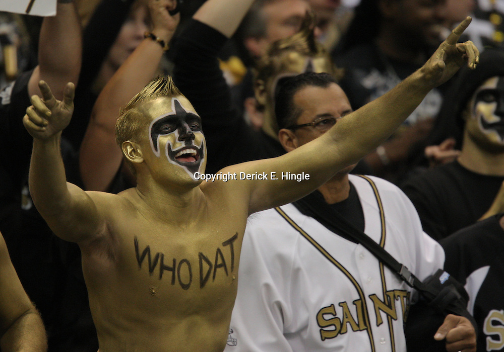 Jan 24, 2010; New Orleans, LA, USA; A New Orleans Saints fan in the stands celebrates during a 31-28 overtime victory by the New Orleans Saints over the Minnesota Vikings in the 2010 NFC Championship game at the Louisiana Superdome. Mandatory Credit: Derick E. Hingle-US PRESSWIRE