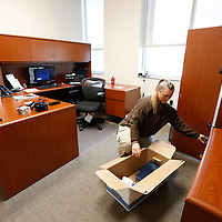 Thomas Wells | BUY AT PHOTOS.DJOURNAL.COM<br /> Tupelo Detective Lynette Sandlin begins her unpacking boxes and getting settled into her new office as the Tupelo Police Headquarters on Front Street where all non-emergency departments will begin using the building Thursday.