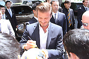 BEIJING, CHINA - JUNE 18: (CHINA OUT) <br /> <br /> David Beckham Leaves Ritz-Carlton Hotel<br /> <br /> David Beckham signs for fans as he leaves Ritz-Carlton Hotel on June 18, 2013 in Beijing, China.<br /> ©Exclusivepix