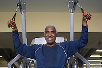 Senior Man Working Out on Weightlifting Machine