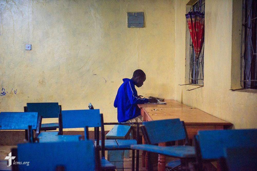A young man at the U-Dom ELCK (Evangelical Lutheran Church in Kenya) Project 24 site studies on Wednesday evening, June 22, 2016, in Chepareria, Kenya.  LCMS Communications/Erik M. Lunsford