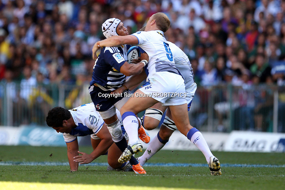 Brett Sheehan of The Western Force gets to grips with Gio Aplon of the Stormers during the Super 15 match between the DHL Stormers and The Western Force held at DHL Newlands Stadium in Cape Town, South Africa on the 26 March 2011..Photo by Ron Gaunt/SPORTZPICS