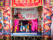 "06 OCTOBER 2014 - GEORGE TOWN, PENANG, MALAYSIA: A Chinese opera performed with puppets at the Hean Boo Thean Kuanyin temple on one of the ""clan jetties"" in George Town (also Georgetown), the capital of the state of Penang in Malaysia. Chinese operas are performed as a part of religious ritual, to entertain the gods, not the people. The ""clan jetties"" are the traditional homes of Chinese people who originally settled in the area centuries ago. Named after Britain's King George III, George Town is located on the north-east corner of Penang Island. The inner city has a population of 720,202 and the metropolitan area known as George Town Conurbation which consists of Penang Island, Seberang Prai, Kulim and Sungai Petani has a combined population of 2,292,394, making it the second largest metropolitan area in Malaysia. The inner city of George Town is a UNESCO World Heritage Site and one of the most popular international tourist destinations in Malaysia.      PHOTO BY JACK KURTZ"
