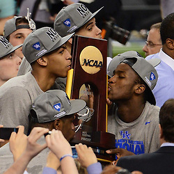 Apr 2, 2012; New Orleans, LA, USA; Kentucky Wildcats forward Anthony Davis (left) and forward Michael Kidd-Gilchrist (right) kiss the NCAA National Championship trophy after defeating the Kansas Jayhawks 67-59 in the finals of the 2012 NCAA men's basketball Final Four at the Mercedes-Benz Superdome. Mandatory Credit: Derick E. Hingle-US PRESSWIRE