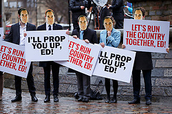 © Licensed to London News Pictures. 26/02/2015. LONDON, UK. Members of the Conservative Party protesting against Labour Party leader Ed Miliband with Alex Salmond masks outside Queen Elizabeth II Conference Centre in London on Thursday, 26 February 2015. Photo credit : Tolga Akmen/LNP
