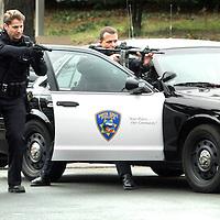 Santa Cruz Police take a suspect into custody in the Washington Mutual Bank parking lot on Ocean Street Friday.<br />Shmuel Thaler/Sentinel