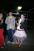 Amelia Power, Ivor Gormley and Paloma Gormley. The Art Party, Tate Modern. a party to raise funds for 'Art for All'. 16 June 2005. ONE TIME USE ONLY - DO NOT ARCHIVE  © Copyright Photograph by Dafydd Jones 66 Stockwell Park Rd. London SW9 0DA Tel 020 7733 0108 www.dafjones.com