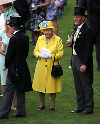 Queen Elizabeth II and Michael Bell, trainer of Fabricate before the Wolferton Stakes during day one of Royal Ascot at Ascot Racecourse.