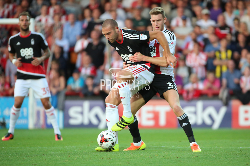 Brentford defender Callum Elder (3) battles for possession with Nottingham Forest midfielder Pajtim Kasami (22)  during the EFL Sky Bet Championship match between Brentford and Nottingham Forest at Griffin Park, London, England on 16 August 2016. Photo by Matthew Redman.