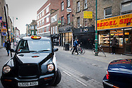 A taxi in the trendy Brick Lane area of Shoreditch, London. UK..Photo@Steve Forrest/Workers' Photos