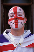 A portrait of a young man with a face painted with the English flag and the letters THFC (Tottenham Hotspur Football Club), a north London club, a effort he has made during an outdoor party celebrating the 50th anniversary of VE (Victory in Europe) Day on 6th May 1995, in London, England. In the week near the anniversary date of May 8, 1945, when the World War II Allies formally accepted the unconditional surrender of the armed forces of Germany and peace was announced to tumultuous crowds across European cities, the British still go out of their way to honour those sacrificed and the realisation that peace was once again achieved. Street parties now – as they did in 1945 – played a large part in the country's patriotic well-being.