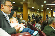 Vatican City oct 9th, 2015, extraordinary synod on family. A family attends to bishops meeting. In the picture Massimo and little Davide in the synod hall