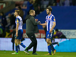 WIGAN, ENGLAND - Monday, February 19, 2018: Wigan Athletic's match-winning goal-scorer Will Grigg celebrates with a supporter after beating Manchester City 1-0 in the FA Cup 5th Round match between Wigan Athletic FC and Manchester City FC at the DW Stadium. (Pic by David Rawcliffe/Propaganda)