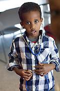 Preschooler listens to his heart