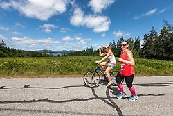 Great Cranberry Island Ultra 50K road race: Molly Damon accompanied by Alison Bradley on bike