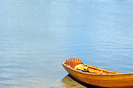 Wooden rowboat at waters edge in Hyannis Cape Cod