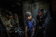 A teenager receives treatment for a severely infected head wound at a makeshift field clinic set up inside an abandoned store on the edge of Mosul's Old City, Iraq, on July 2, 2017. Having no access to proper medical care while trapped in the Old City, many civilians arrived at the clinic in need of emergency treatment for wounds that had become infected.<br /> <br /> Volunteer medics from international medical organisations Global Response Management and Academy of Emergency Medicine, together with Iraqi forces medics, worked around the clock providing pre-hospital care to civilians and soldiers as the fighting continued to liberate the remaining pocket of ISIS-controlled territory in Mosul.