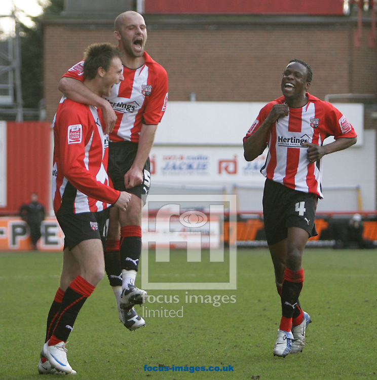 London - Saturday, March 14th, 2009: Goalscorer Sam Williams (L) of Brentford celebrates with team mates David Hunt (C) and Marcus Bean during the Coca Cola League Two match at Griffin Park, London. (Pic by Mark Chapman/Focus Images)