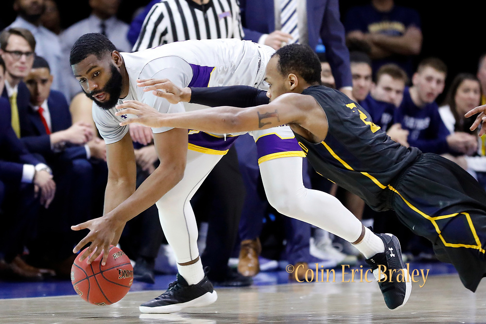 LSU Alexandria forward Trent Brinkley, left, and Graceland guard LT Davis, center, battle for a loose ball during the second half of a NAIA championship men's college basketball game, Tuesday, March 20, 2018, in Kansas City, Mo. (AP Photo/Colin E. Braley)