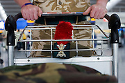Off-duty soldier returning from active service in Afghanistan wheels baggage through departures at Heathrow's terminal 5.