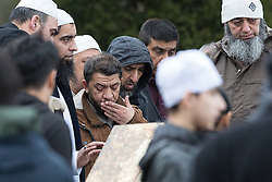© Licensed to London News Pictures . 03/03/2016 . Manchester , UK . Shahzaib's father JAVID HUSSAIN watches as Shahzaib Hussain is buried at Ashton Hurst Cemetary . Shahzaib was killed by a hit and run driver outside the mosque , on Monday 29th February 2016 . Photo credit : Joel Goodman/LNP