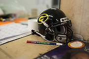 A Grambling State University mini football hellmate sits on the desk of Richard Gallot in Grambling, Louisiana on October 23, 2013. Gallot owns a barbershop on the main drag in Grambling but also works as a Justice of the Peace and Notary Public.   (Cooper Neill for The New York Times)