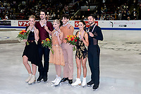 KELOWNA, BC - OCTOBER 26: Ice dance silver medalists, Madison Hubbell and Zachary Donohue of the United States, and gold medalists Piper Gilles and Paul Poirier of Canada and bronze medalists Lilah Fear and Lewis Gibson of Great Britain stand on the ice during medal ceremonies of Skate Canada International held at Prospera Place on October 26, 2019 in Kelowna, Canada. (Photo by Marissa Baecker/Shoot the Breeze)