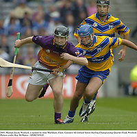 24 July 2005; Michael Jacob, Wexford, is tackled by Alan Markham, Clare. Guinness All-Ireland Senior Hurling Championship Quarter-Final, Wexford v Clare, Croke Park, Dublin. Picture credit; Ray McManus / SPORTSFILE