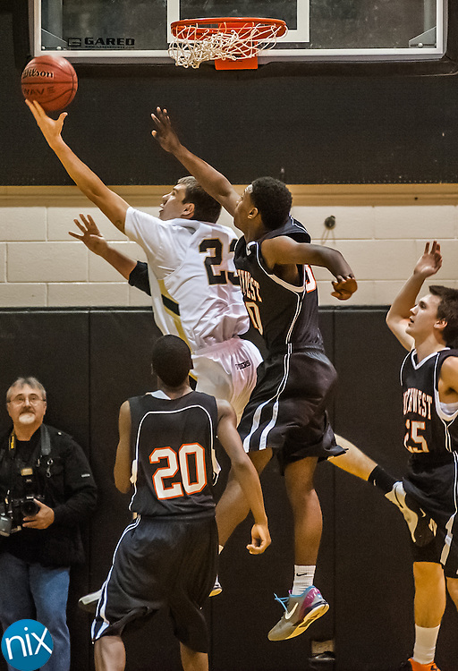 Concord's Jerry Burk goes up for a shot against Northwest Cabarrus Tuesday night at Concord High School. Concord defeated the Trojans 92-80.