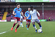 Scunthorpe United player Alex Gilliead (20) and Colchester United player Kwame Poku(49) during the EFL Sky Bet League 2 match between Scunthorpe United and Colchester United at Glanford Park, Scunthorpe, England on 14 December 2019.
