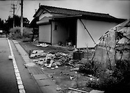 Evidence of looting of a house inside the 20 km (12.4 miles) nuclear exclusion zone.  The police have intensified patrols but the area inside the zone is just too vast to patrol effectively and prolonged exposure to radiation, of course, is harmful to their health.  Near Odaka, Fukushima Prefecture, Japan.  As of midnight 21 April 2011, the Japanese government declared the no-entry zone off-limits under the Disaster Countermeasures Basic Law which gives the police the power to detain anyone entering the zone for up to 30 days and impose a fine of up 100,000 JPY (US$1,200).