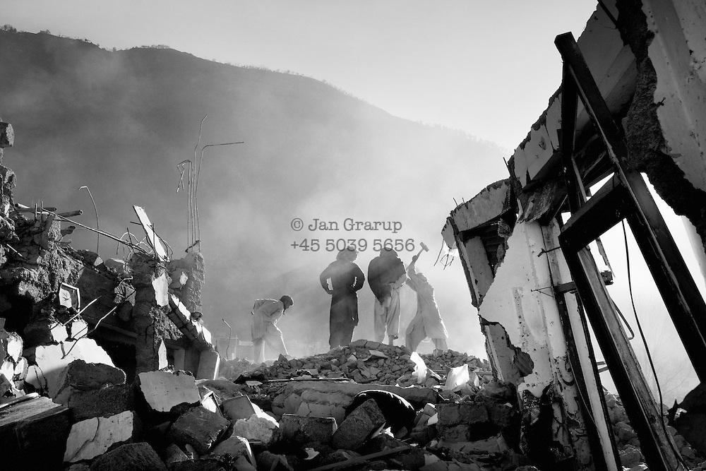 Men digging in the ruins of Balakot.  Dec. 2005-