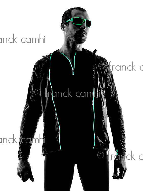 one man runner jogger  portrait  in silhouette isolated on white background