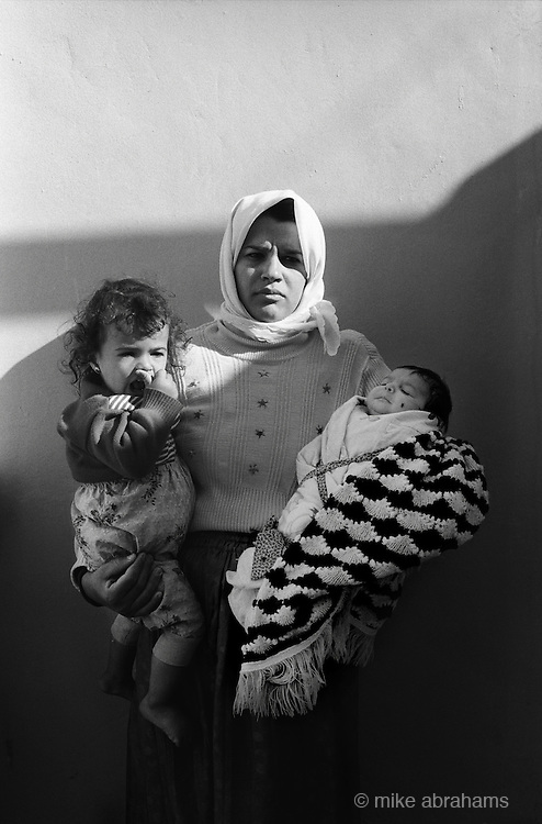 Jabalya Refugee Camp, Gaza 1988. Mother with her two children. The familly's house has been demolished by the Israel Army as punishment for opposing the occupation.